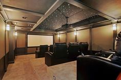 What a beautiful home theater. Click on the picture to see the hidden bookcase door of this theater!