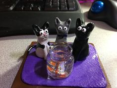 My three cats and goldfish I made with polymer clay