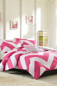 Loving how this pink mi-zone comforter adds a pop of color to this modern bedroom space! Click to shop the look on Wayfair.