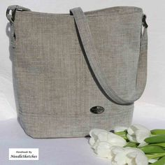 A Blue/Grey Shoulder Bag, with cotton lining, matched-fabric shoulder strap, slim magnetic closure, leather base and two inner pockets. Handmade Fabric Bags, Handmade Market, Grey Fabric, Slow Fashion, Bag Making, Blue Grey, Bucket Bag, Shoulder Strap, Reusable Tote Bags