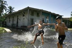 September 2, 2008 Pictures of the Day - Photo Journal - WSJ Children cooled off Saturday in a Batabano, Cuba, canal in the aftermath of Hurricane Gustav. No deaths and only 19 injuries were reported after Hurricane Gustav hit the western part of Cuba. (Photo: Javier Galeano/Associated Press)