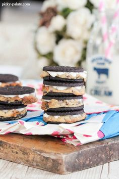 Chocolate Chip Cookie Stuffed Oreos  - totally doing this with Halloween oreos and maybe an orange drizzle on top, too.