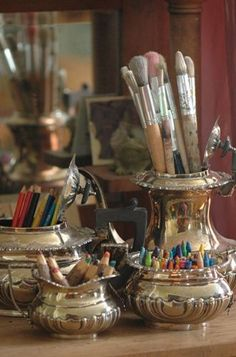 Art supplies stored in silver serving pieces- showing different ways to use things. Inspiring ideas