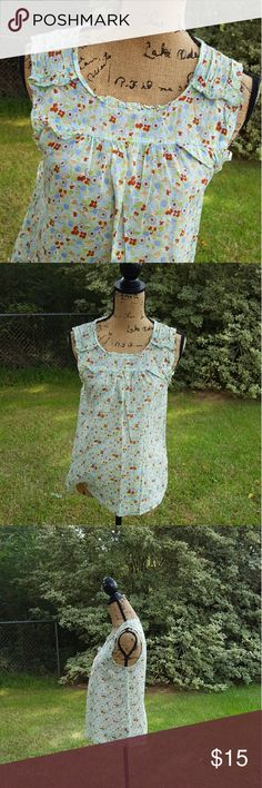 "Anthropologie Left of Center Small Floral Blouse Anthropologie brand Left of Center Simple Floral Cotton Blouse Size Small . Sleeveless Design. Excellent Condition.  Measurements : Length 24"" 17"" across front laying flat   #ravenkittystyle #anthropologie #leftofcenter #floral #hippiechic #boho #hippie #girly #casual #cotton#simple #small Anthropologie Tops Blouses"