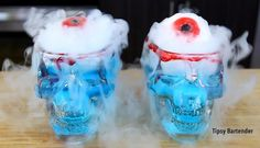THE SKULL EYEBALL COCKTAIL Eyeballs: Blueberries  Gummy Life Savers Tonic Water  Blood: Corn Syrup Red Food Coloring  Blue Cocktail 1 oz. (30ml) Citrus Vodka 1 oz. (30ml) Tonic Water Splash Blue Curacao Splash Lemonade (optional)   *This drink also glows in the dark!