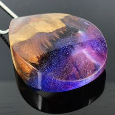 Just three pieces are going up today, but this beauty is amongst them!  Galaxy in a pendant! Wood and resin pendant necklace. Handmade jewelry by WoodAllGood. #WoodAllGood