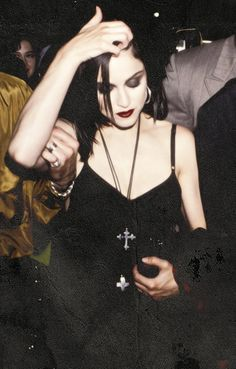 Goth fashion: style in the early 1980's, adapted from characters in gothic novels like vampires, wore black gowns and accessories like silver crosses.