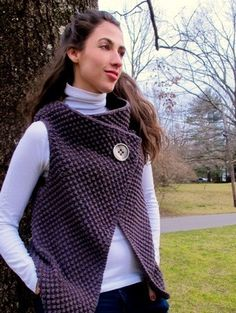 Interesting take on the plethora of square-fronted vests/sweaters out there. Not sure I'm a fan of the style in general, but I do like this application. The heft of the stitch pattern balances the drape of a style that's otherwise falling off the body due to lack of shaping. Would like to see it unbuttoned; how would it fit then?