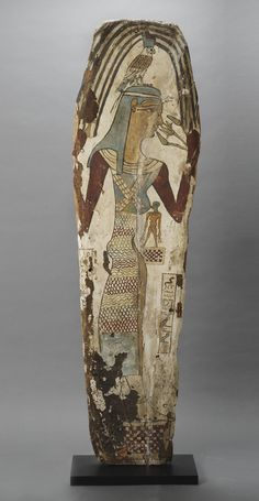 Egyptian Panel from a Sarcophagus Depicting Isis and Horus,         Origin: Egypt Circa: 650 BC to 550 BC
