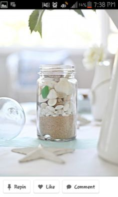 Beach wedding table decorations...we could use the teal mason jars...a little pricey for vintage ones but they just came out with an anniversary set, you could get @ any store selling canning jars