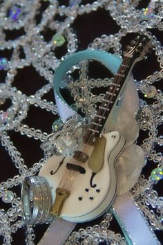 Lets make music!!! :  wedding boutonniere brown diy guitar music teal IMG 0820