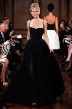 Romona Keveza Spring 2012 collection. Gorgeous black ball gown with full skirt and spaghetti-strapped bustier. Love it!