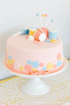 Cake at a sewing themed birthday party via Kara's Party Ideas | Kara Allen | KarasPartyIdeas.com A lot of cute as a button elements, decor, cupcakes, food, games and more!_-67