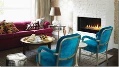 Purple couch; turquoise chairs