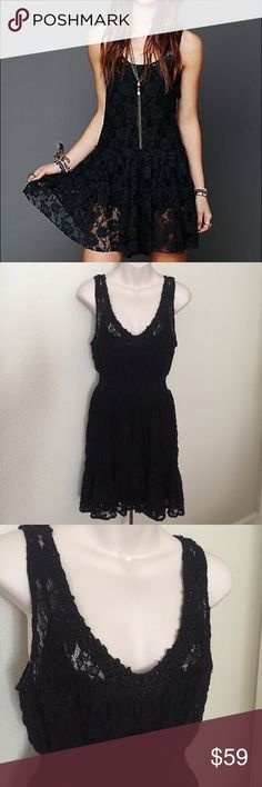 """Free People Lace Beaded Ruffle Tank Dress Black This is a beautiful Free People Lace tank dress. Black lace with a ruched waist and Ruffle bottom. Size medium. Comes with a black Slip inside. Made of nylon and cotton. Bust 36"""" waist 24"""" unstretched.. mint condition. Free People Dresses"""