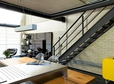 The Industrial Loft is designed by Diego Revollo, an interior designer based in Sao Paulo, Brazil. The 100 square meter loft is also located in Sao Paulo Loft Estilo Industrial, Industrial House, Industrial Chic, Casa Loft, Loft House, Loft Kitchen, Kitchen Island, Lounge Chair, Loft Interiors