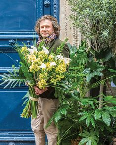 Parisian florist Stephane Chapelle stands against the bright blue painted door of his French flower shop holding a massive bouquet of tropical yellow flowers and foliage. French Flowers, All Flowers, Tropical Flowers, Yellow Flowers, Garden Pavilion, Pink Bouquet, Bouquets, Spring Blooms, Clematis
