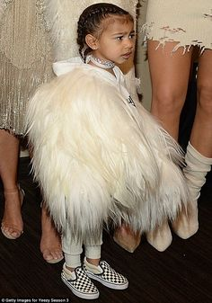 Model-in-waiting: A girl who can pull off a hoodie with furry wings is surely destined for...