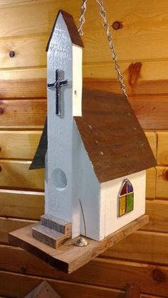 This is an adorable country church bird house complete with Stained Glass Windows and Cross. It includes a special church mouse sitting by the front step! This is made from Reclaimed Oak barnwood and reclaimed corrugated tin and is sealed for use i Bird House Plans, Bird House Kits, Bird Houses Painted, Bird Houses Diy, Painted Birdhouses, Homemade Bird Houses, Bird House Feeder, Bird Feeders, Corrugated Tin