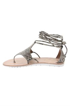 Free-spirited this sandal will fit right in with your boho collection! Beige snakeskin print acts as a perfect chic neutral against all of your sundresses. The rubber sole makes it ideal for all-day wear. Full sizes only. If between size up.  Snakeskin Lace-Up Sandal by Diba True. Shoes - Sandals - Flat Atlanta Georgia