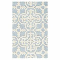 """Anchor your living room or define a space in your master suite with this hand-tufted wool rug, showcasing a quatrefoil motif in light blue and ivory.  Product: RugConstruction Material: WoolColor: Light blue and ivoryFeatures:  Hand-tuftedMade in IndiaPile Height: 0.63"""" Note: Please be aware that actual colors may vary from those shown on your screen. Accent rugs may also not show the entire pattern that the corresponding area rugs have."""