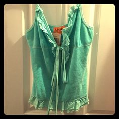 NWT Juicy Couture Terry Cloth Tank-top with tie!! NWT, Authentic, Juicy Couture, Aqua Blue, Terry Cloth, Tank Top, Can be tied in the front or back (as seen in pictures). Will fit sizes Small & Medium. Adorable spring/summer top... Great for over a bathing suit too! Make an offer- looking to clean out my closet & therefore eager to sell!! xo Juicy Couture Tops Tank Tops