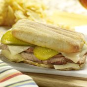 "Cuban Sandwich.  In place of this recipe you can also use Italian bread,Ranch dressing with bacon,spicy brown mustard [ on opposite sides of the loaf] and the same meats, cheese and pickles.I call this one the ""Bermuda Sandwich"""
