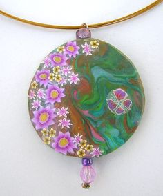 Flowery Round Pendant  made of polymer clay. $28.00, via Etsy.