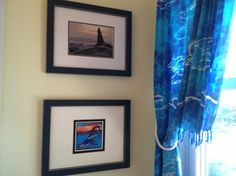 Use sarongs (beach wrap skirt) to make beachy curtains. These have dolphins on them. Very inexpensive and colorful.
