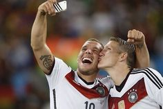 A new selfie!  Schweinsteiger and Podolski celebrating the German win in the 2014 World Cup.