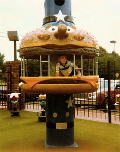 Unknown Source - Children explore a Big Mac Climber. Also seen are clear depictions of the bouncer spring toys featuring Captain Crook's boat and Filet-O'-Fish!