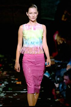 Julien Macdonald | Spring 2000 Ready-to-Wear | 86 Green/blue tie-dye sleeveless top with fringed hem and pink midi skirt