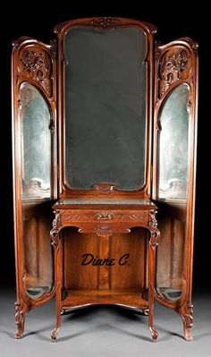 Very fine, French, Art Nouveau period, trifold mirror with vanity. In solid, carved walnut. In the manner of Majorelle. Circa 1900.