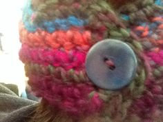 Back view of ear warmer with button