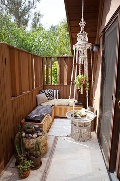 Bohemian outdoor seating on the left side along the fence. old crates etc etc etc