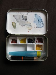 Travel watercolor set:in a  modified Altoids Tin. Pop out the paint pots from an old watercolor set, or shop for some with straight sides, that will fit.