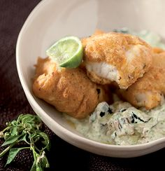 Chilli-bite battered fish with brinjal-and-coriander tzatziki Seafood Recipes, My Recipes, Healthy Recipes, Battered Fish, Tzatziki, Biryani, Fish And Seafood, Fritters, Coriander