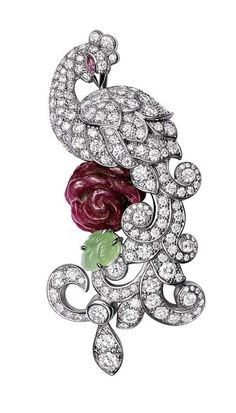 Cartier Fabuleux Peacock brooch  in rhodium-plated white Gold set with brilliant-cut Diamonds, with a natural ruby crystal flower, leaf engraved Nephrite Jade leaf and eye set with a Sapphire.