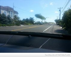 Tried To Take A Photo Of A Grasshopper On My Windshield
