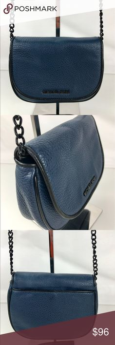 "Michael Kors French Binding Leather Crossbody Authentic. Gently used. Good condition inside and out with a few minor marks on backside.   Pebbled navy leather with black leather trim. Black tone hardware. Exterior back slide in pocket, 1 slip pocket interior. Flap top with magnetic closure. Adjustable crossbody strap with 21"" drop. 5.5"" H x 7"" W x 3"" D. RB748.  Thank you for your interest!   PLEASE - NO TRADES / NO LOW BALL OFFERS / NO OFFERS IN COMMENTS - USE THE OFFER LINK :-) Michael Kors…"