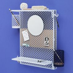 Inga Sempé has created this pinboard for Danish brand Hay from metal mesh so users can add extra storage components and accessories to make it more useful.