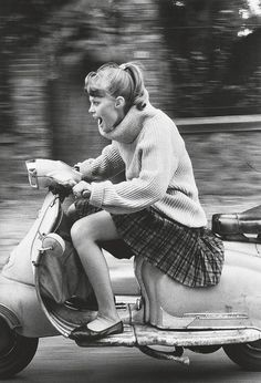 French girl speeding on a scooter 1984.