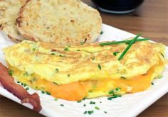 Bacon, Cheddar & Chives Omelette Recipe Omelettes can be a tad bit tricky but the Bacon, Cheddar & Chives Omelette is a tasty breakfast treat that will make it worth the challenge.  You can go wrong with a breakfast of bacon, eggs, and cheese all melted and wrapped together.