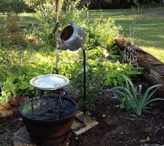 A kettle fountain I read about-not mine but I love it!  http://www.hometalk.com/594089/my-hubby-spent-an-hour-at-lowes-figuring-out-how-to-make-this-i-love-it#