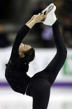 Mao Asada, of Japan, performs during a practice session for the World Figure Skating Championships, Tuesday, March 12, 2013, in London, Ontario.