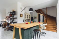 Plain timber boards clad the walls and ceiling of the extensions, and the dining room, living room and kitchen share a terrazzo-style floor. Quirky Kitchen Island, Open Plan Kitchen, Dining Room Walls, Dining Area, Living Room, Green Drawers, Cheap Cottages, Timber Boards, Iron Balcony