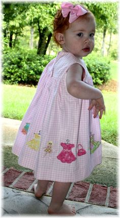 """Pretty little baby girl - dressed up with a machine embroidered frock embellished with machine embroidery designs from """"Baby Girl Fashions"""" collection."""