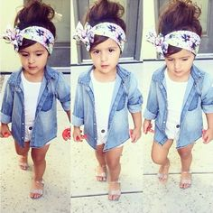 This cute little girl wears a denim jacket with a nice flower headband