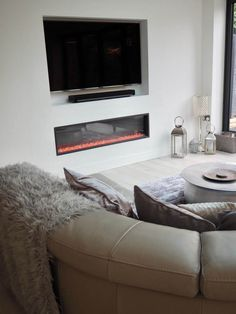 A cosy corner of a Scandinavian inspired white modern contemporary open plan kitchen living room with bi folding doors. Tv In Kitchen, Open Plan Kitchen Living Room, Open Plan Living, Kitchen Ideas, Contemporary Open Plan Kitchens, Modern Contemporary, Tv Fireplace, Cosy Corner, Tv Wall Design