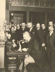 Alexander Graham Bell on the telephone in New York (calling Chicago), 1892.